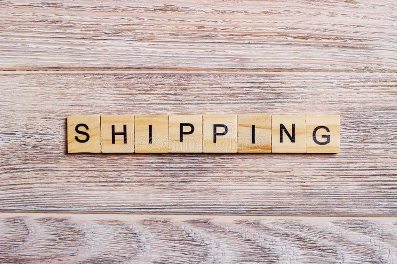 SHIPPING word on block concept on a wooden background.  royalty free stock images