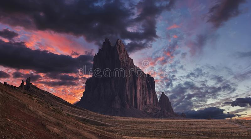 A Shiprock Landscape Against a Breathtaking Twilight Sky royalty free stock photos