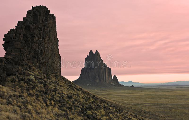 A Shiprock Landscape Against a Pink Dawn Sky royalty free stock photos