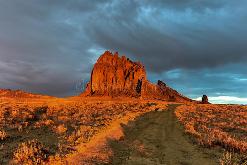 Shiprock - New Mexico. Shiprock is a monadnock rising nearly 1,583 feet above the high-desert plain of the Navajo Nation in San Juan County, New Mexico, United royalty free stock images