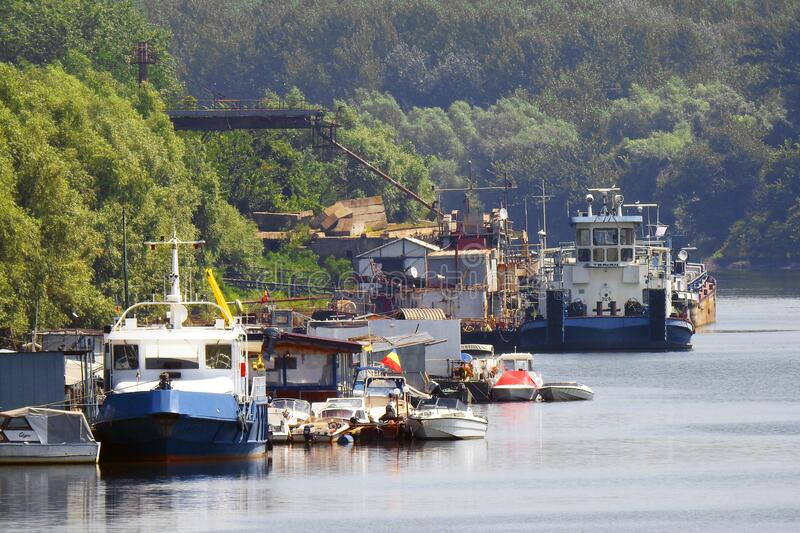Ships anchored at the shore. At the docking port, on the river royalty free stock images