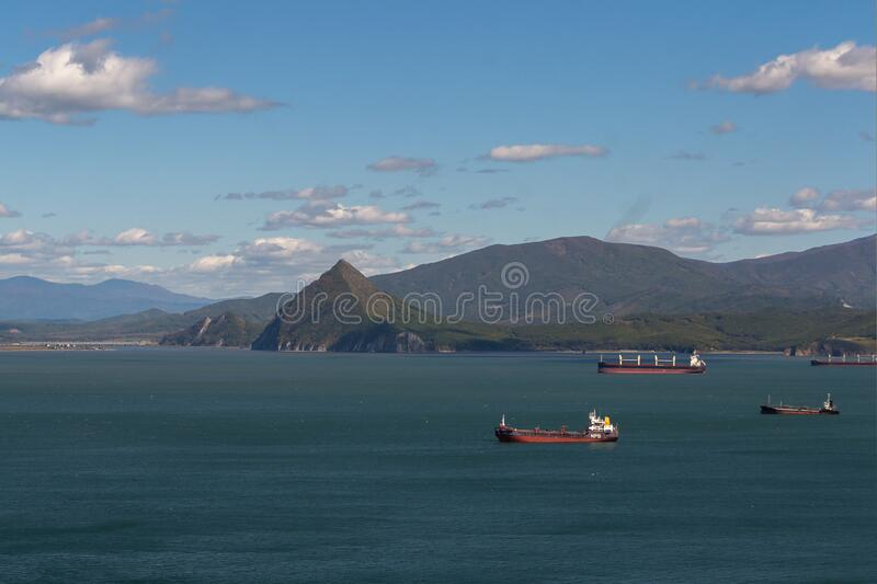 Ships in the Bay against the background of mountains. stock photos