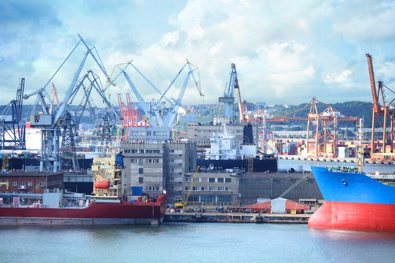 Ships and cargo cranes in Gdansk, Port of Poland royalty free stock image