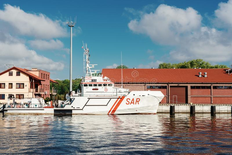 Search and Rescue boat moored at berth. White boat with red liine on hull. royalty free stock photos
