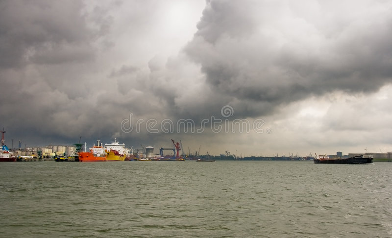 Ships and clouds. Dark rainclouds are coming in from the sea royalty free stock images