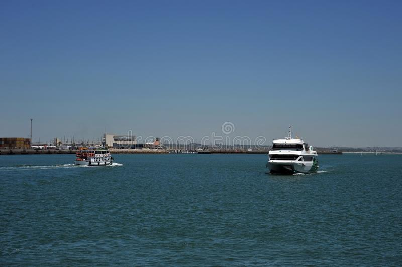 Ships in the harbor of the seaport of Cadiz on the shores of the Cadiz Bay of the Atlantic Ocean. royalty free stock image