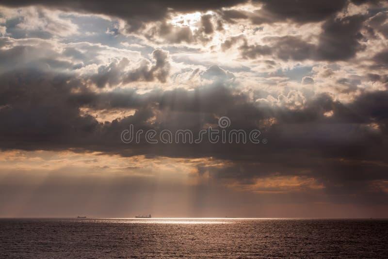 Ships on the horizont of sea. Summer sea sunrise with ships on the horizont stock photo