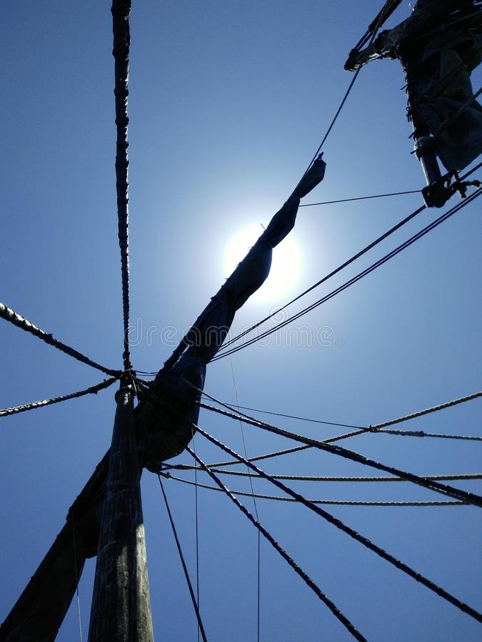 Ships mast, sail and ropes royalty free stock photography