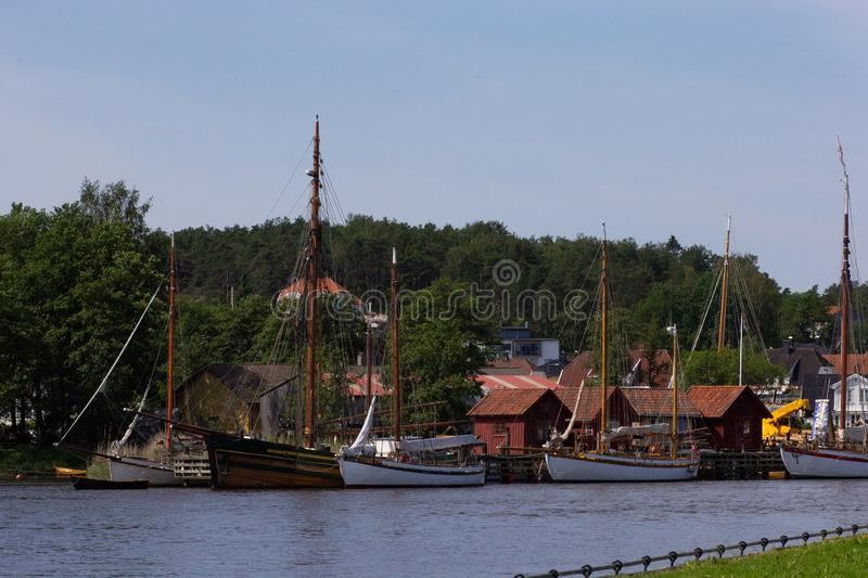 Ships with masts on the river Glomma in Fredrikstad city Norway. Ships on the river Glomma in Fredrikstad city Norway stock image