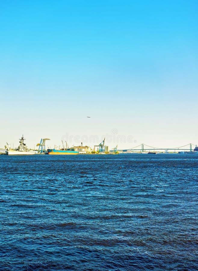 Ships near Benjamin Franklin bridge over Delaware River in Philadelphia stock photography