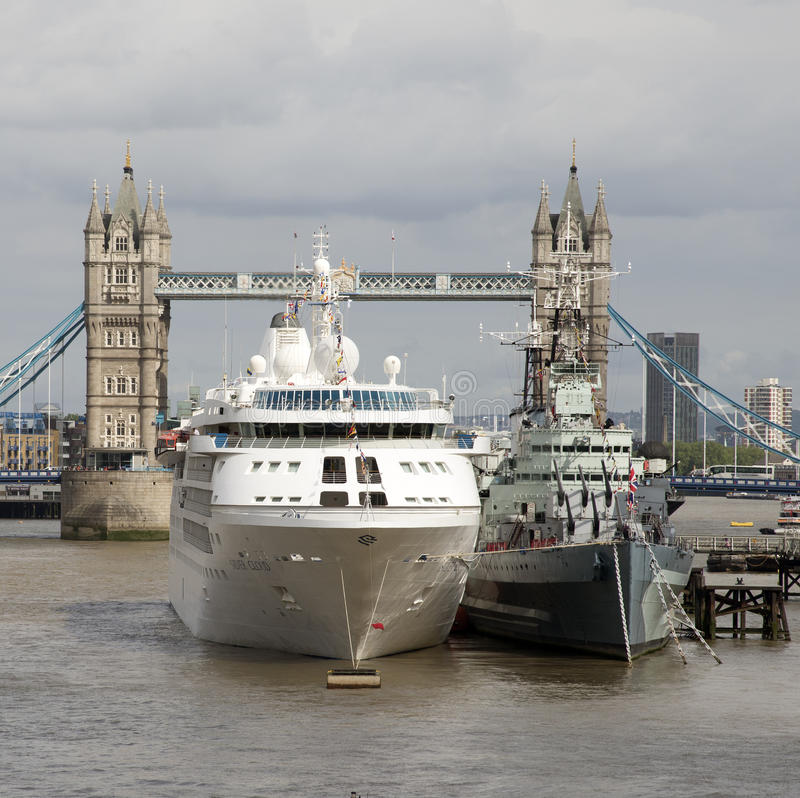 Ships In The Shadow Of Tower Bridge London UK Editorial - Cruise ship in london