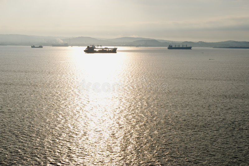 Download Ships silhouetted on ocean stock image. Image of coastline - 8314323