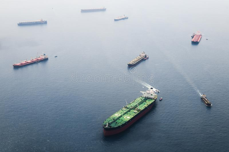 Big tanker with two helicopter platforms stay on anchor stock images