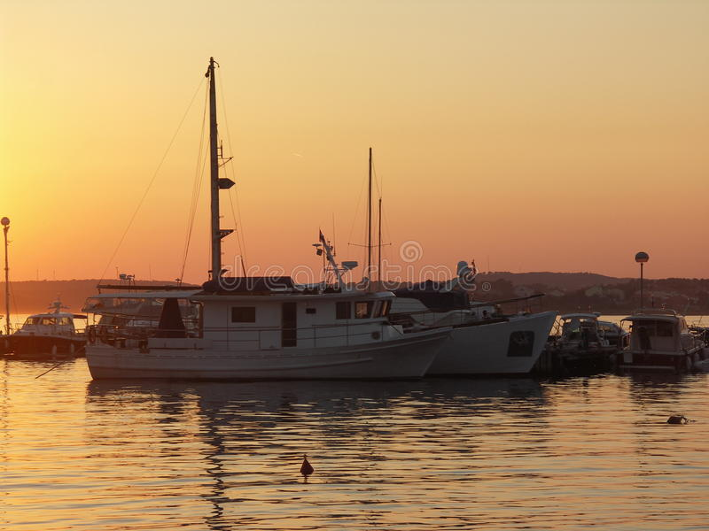 Download Ships in sunset stock image. Image of harbor, ship, water - 30585499