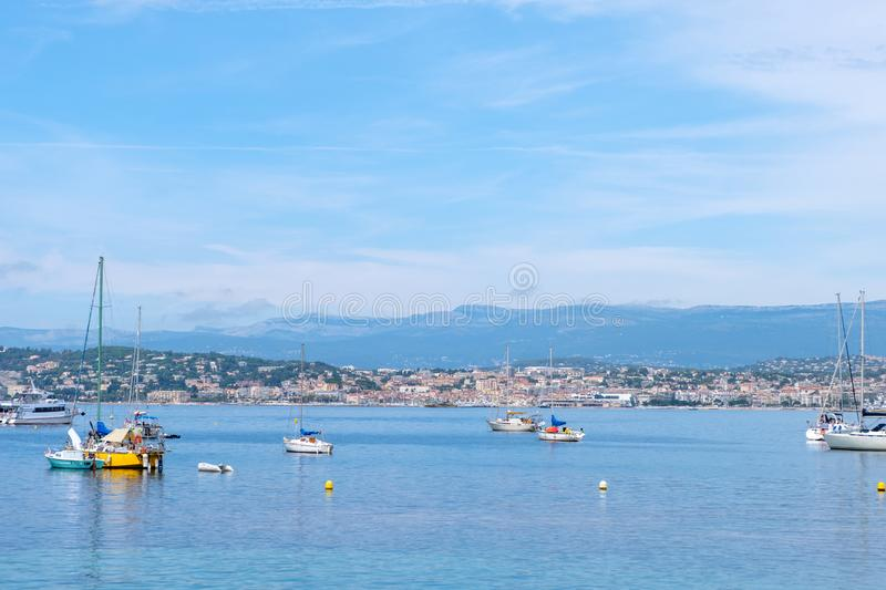 Ships on water at daylight. Vibrant blue water and sky. Place for text. Cannes, France royalty free stock image