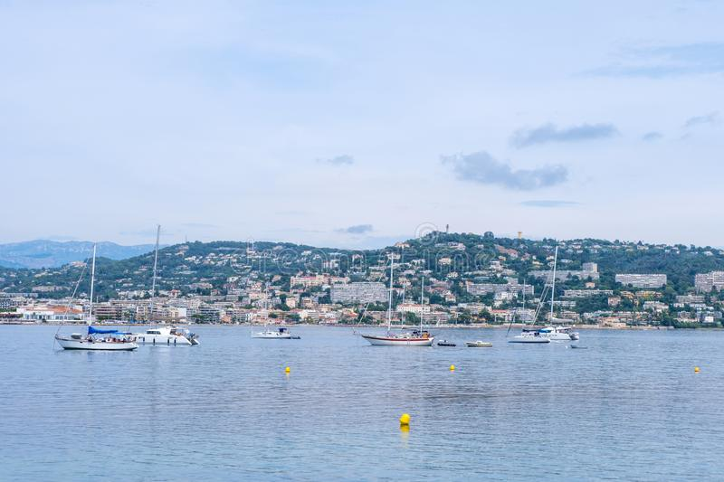 Ships on water at daylight. Vibrant blue water and sky. Place for text. Cannes, France royalty free stock photos