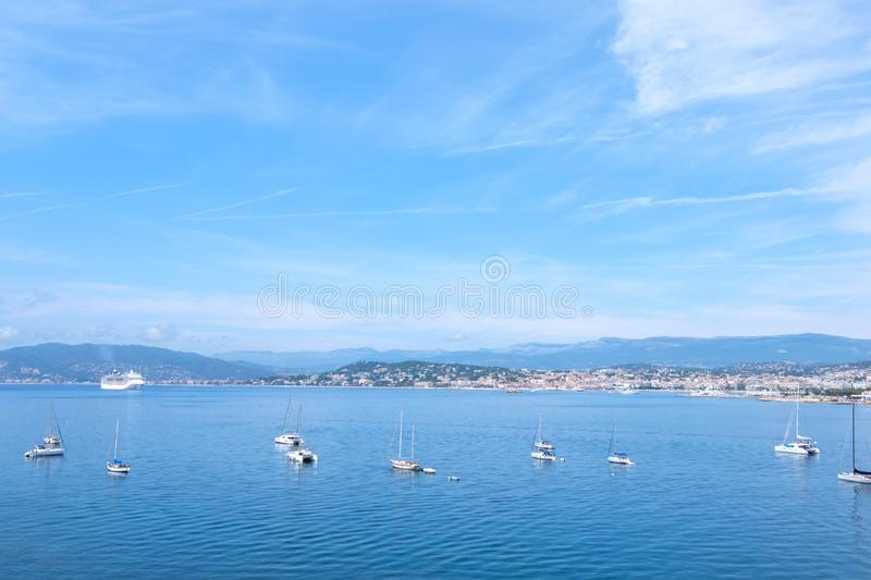 Ships on water at daylight. Vibrant blue water and sky. Place for text. Cannes, France stock image