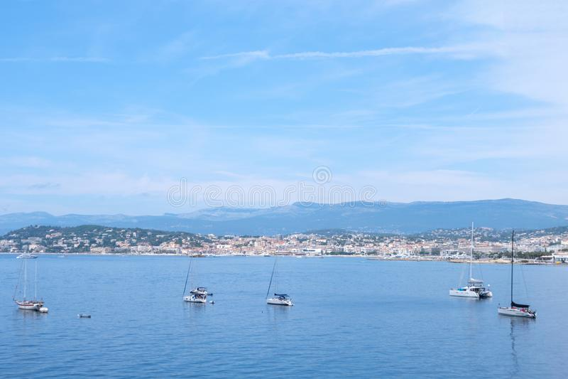 Ships on water at daylight. Vibrant blue water and sky. Place for text. Cannes, France royalty free stock photography