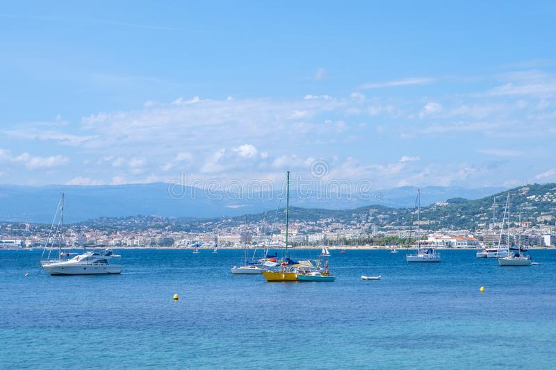 Ships on water at daylight. Vibrant blue water and sky. Place for text. Island Sainte-Marguerite, Cannes, France royalty free stock photos