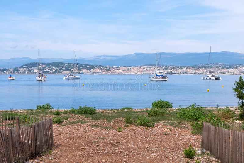 Ships on water at daylight. View from garden. Vibrant blue water and sky. Place for text. Cannes, France stock photo