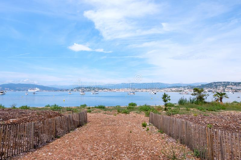 Ships on water at daylight. View from garden. Vibrant blue water and sky. Place for text. Cannes, France stock photos