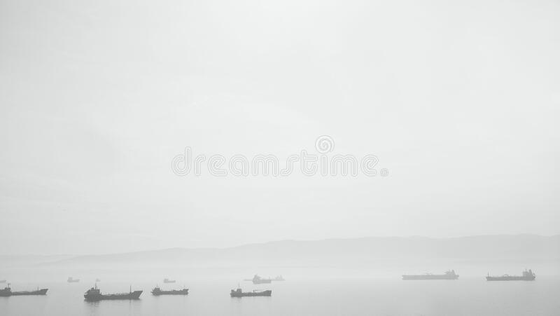 Ships in Water with Fog royalty free stock photo