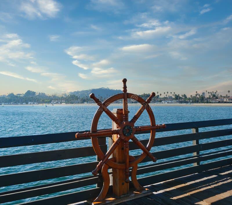 Ships Wheel on Pier royalty free stock photo