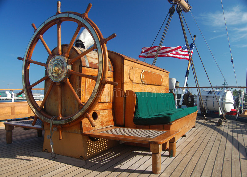 Ships Wheel and Seat stock photos