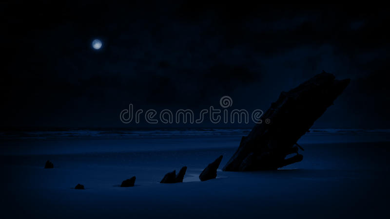 Shipwreck On Beach In The Moonlight. Old weathered shipwreck in the sand at night with moon above stock video footage