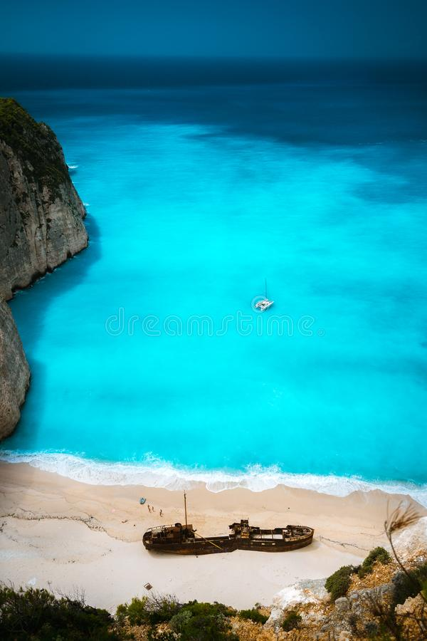 Shipwreck in Famous Navagio beach. Azure turquoise sea water and paradise sandy beach. Tourist visiting landmark on. Zakynthos island, Greece stock images