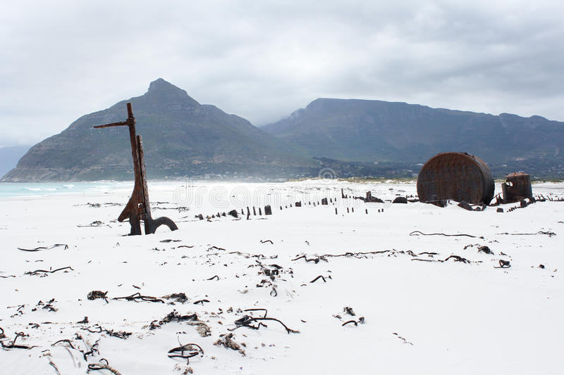 Shipwreck Kakapo at the beach of kommetjie. With upcoming storm in the background stock photos