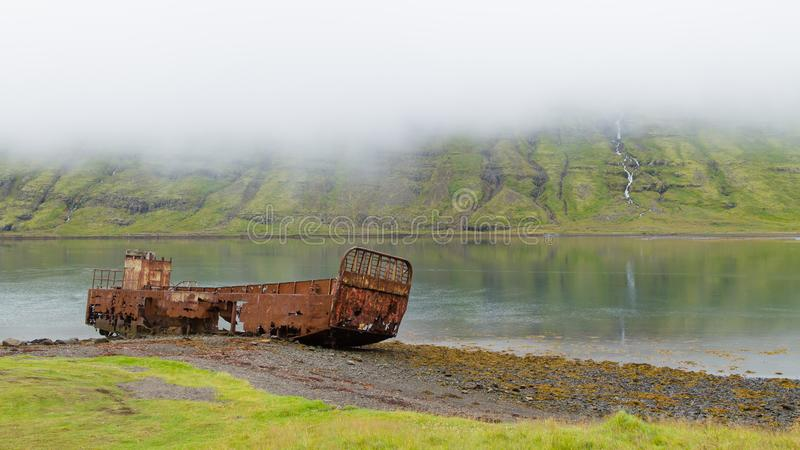 Shipwreck from Mjoifjordur fiord, east Iceland. Icelandic panorama royalty free stock photos