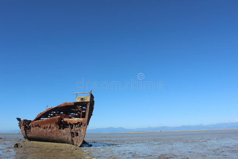 Shipwreck old wrecked ship rust stock photo
