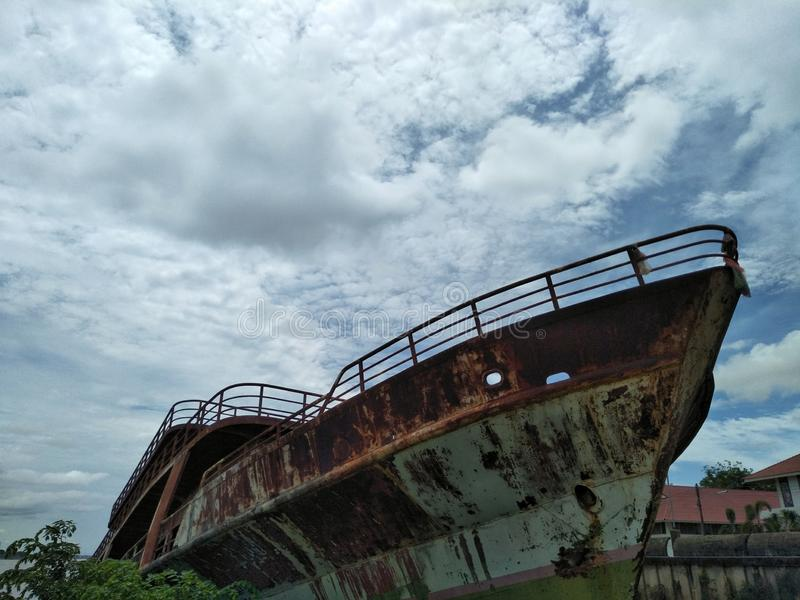 Shipwreck at the riverside on the cloudy day. stock images