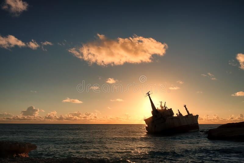 Shipwreck Silhouette At Sunset  royalty free stock images