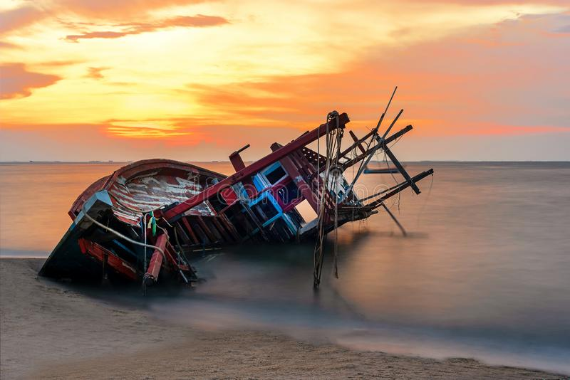 Shipwreck or wrecked boat on beach in the suset. Beautiful Landscape stock photography