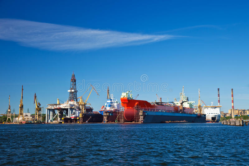 Shipyard. A large cargo ships is being renovated in shipyard Gdansk, Poland stock photography