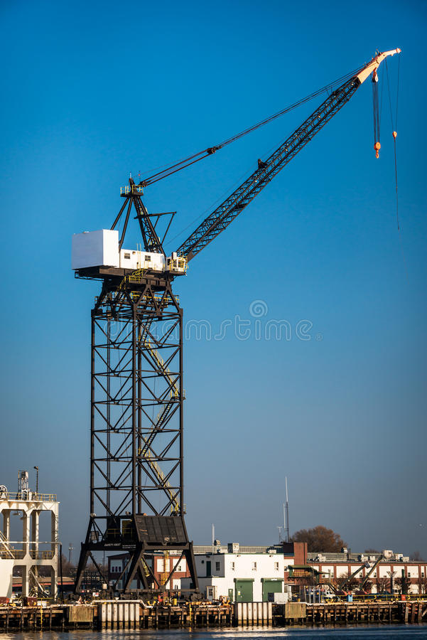 Shipyard Crane. A Naval Shipyard crane in downtown Norfolk Virginia on the Elizabeth river in Hampton roads royalty free stock photography
