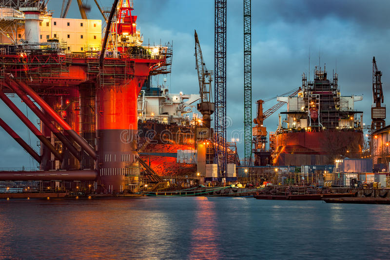 Shipyard at dusk. Shipyard industry - Oil Rig under construction in Gdansk, Poland royalty free stock image