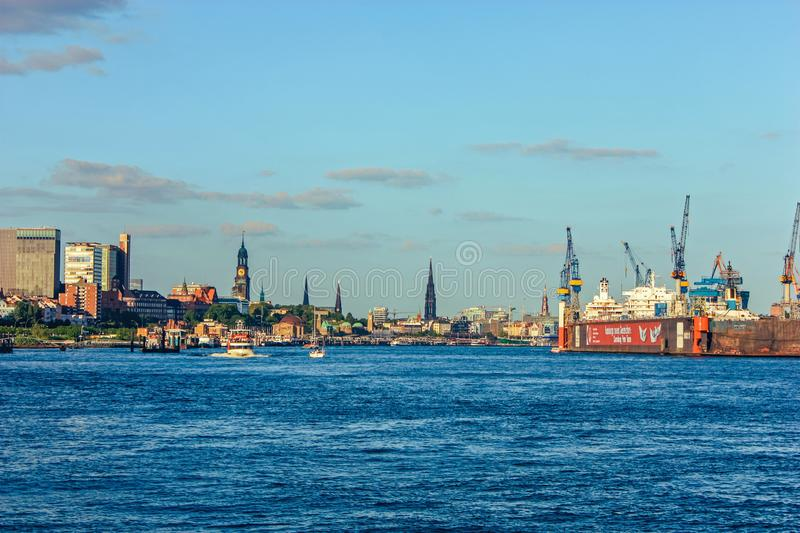 Shipyard and harbor shipbuilding with crane machine and container ship in Hamburg Germany stock images