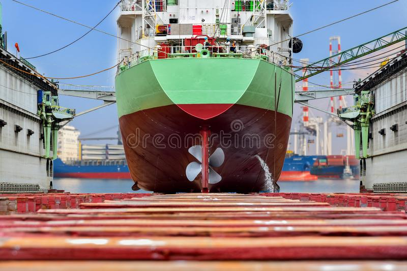 Shipyard industry Big ship on floating dry dock Thailand. Shipyard industry Big ship on floating dry dock, Cargo ship Moored on sleeper wood in dry dock view royalty free stock images