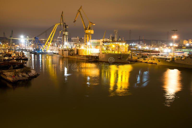 Shipyard at night. Night work of cranes shipyard in the transport of components in Gdansk Ship Repair Yard royalty free stock photography