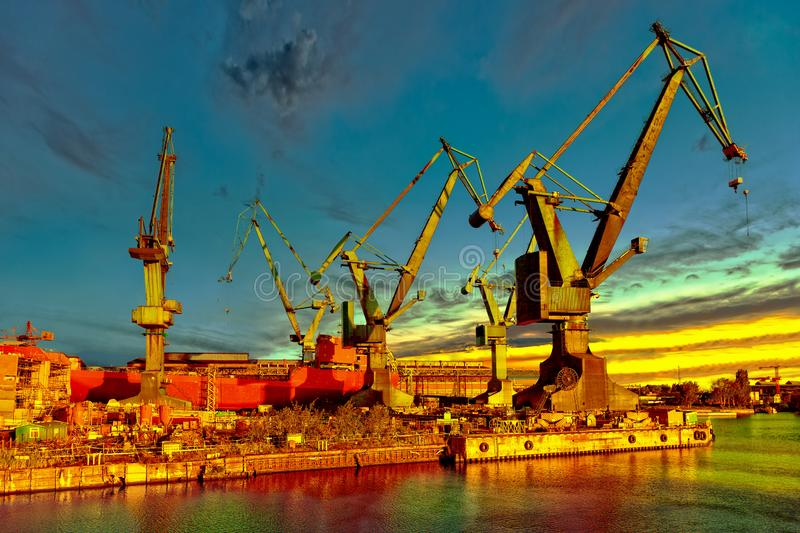 Shipyard at sunrise royalty free stock photography