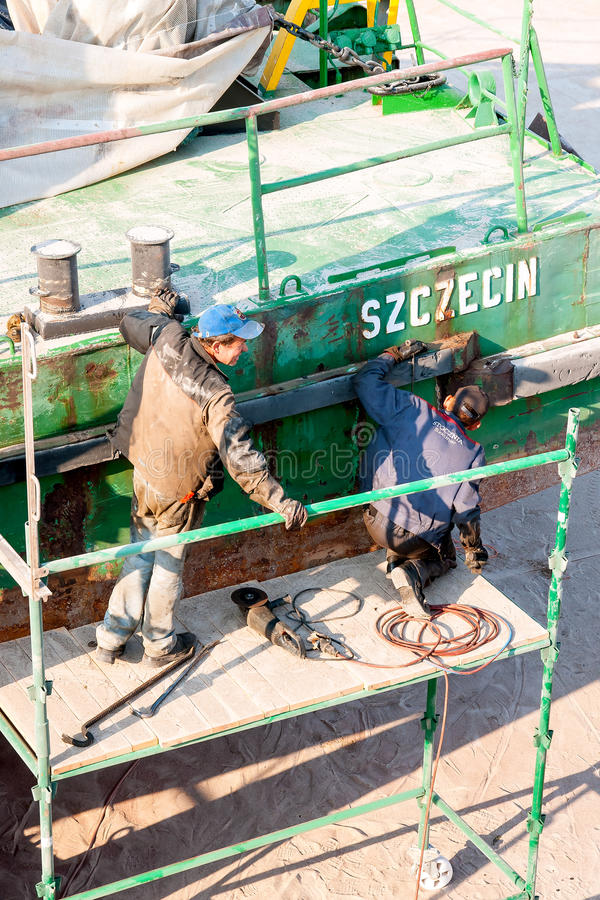 Shipyard workers. During the dismantling of the pontoon fenders stock photography
