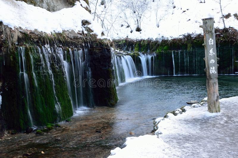 Shiraito Frozen Waterfall in Japan. Shiraito Waterfall is located on the base of a volcanic mountain in Nagano prefecture, Western Japan. This waterfall is the royalty free stock photo