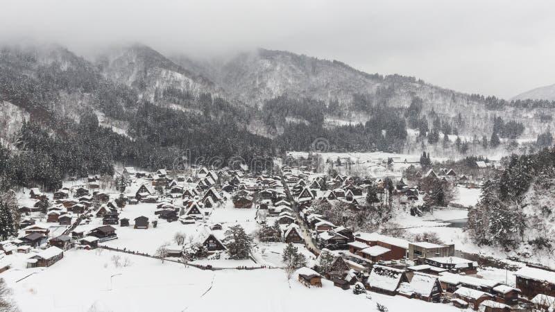 Shirakawago village with snow fall in winter season . Landmark of Gifu , Takayama , Japan . View point landscape royalty free stock image