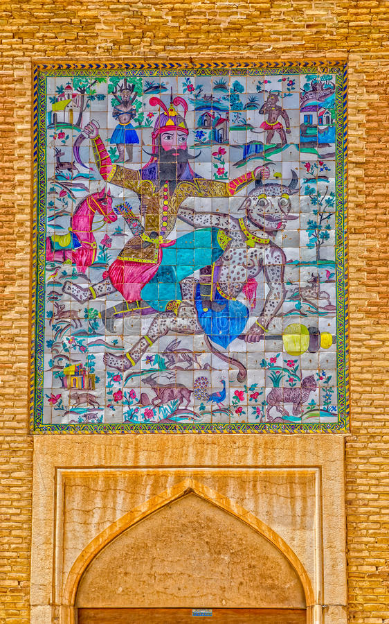 Shiraz Citadel mosaic. SHIRAZ, IRAN - MAY 2, 2015: Entrance picture on the wall of the Rostam overcoming the Demon on old citadel Karmin Khan in the centre of royalty free stock photo