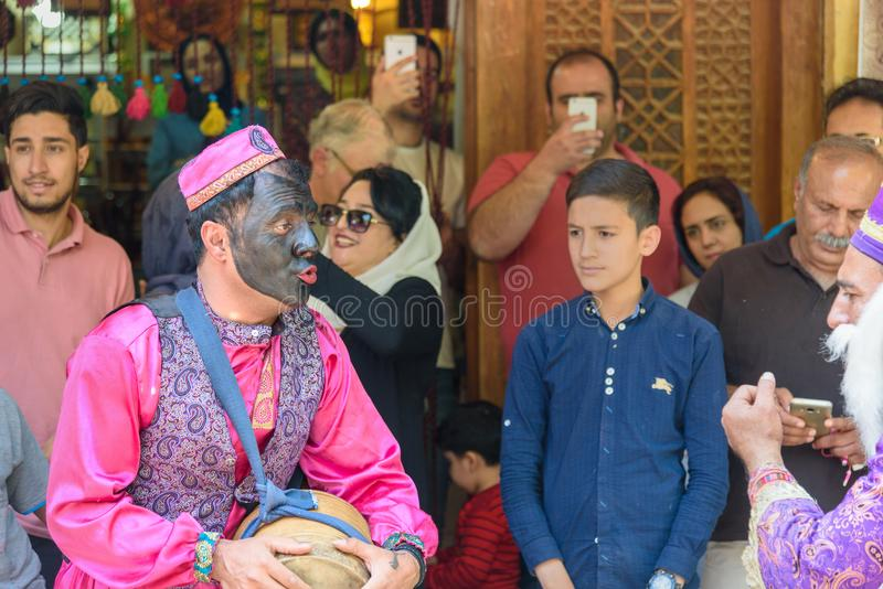 Dancers musicians with black face dance in the street in Bazaar to spread good cheer in Nowruz holidays. Shiraz. Iran. Shiraz, Iran - March 25, 2018: Dancers stock image