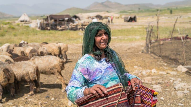 Qashqai nomadic woman selling handicraft materials, Shiraz, Iran royalty free stock photo