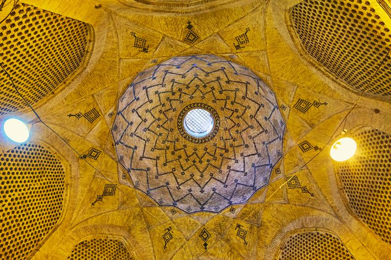 The dome in old Shiraz market, Iran. SHIRAZ, IRAN - OCTOBER 12, 2017: The brick dome of Saray-e Moshir, historic area of Grand Bazaar, decorated with geometric stock images
